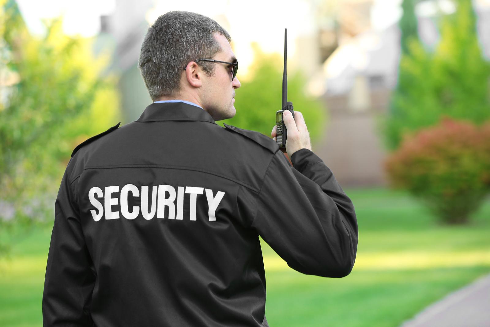 bigstock-Male-security-guard-in-park-158811245